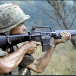 "Soldier aiming a rifle during Operation ""Cook"", 8 September 1967, Quang Ngai Province, Republic of Vietnam"