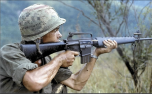 """Soldier aiming a rifle during Operation """"Cook"""", 8 September 1967, Quang Ngai Province, Republic of Vietnam"""