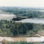 US Huey helicopter spraying Agent Orange