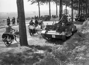 Bren gun carriers pass Belgian refugees on the Brussels-Louvain road, 12 May 1940