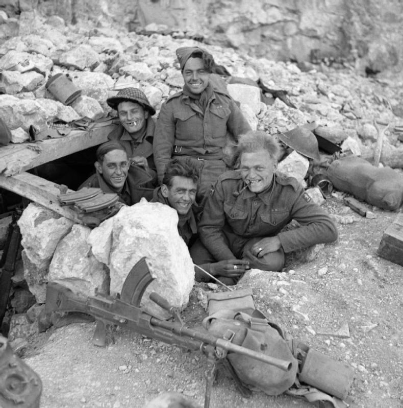Men_of_the_Royal_West_Kent_Regiment_in_a_dugout_on_Monastery_Hill_at_Cassino,_Italy,_26_March_1944__NA13362